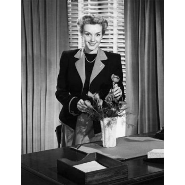 Posterazzi SAL25548449C Businesswoman Arranging Flowers & Smiling Poster Print - 18 x 24 in. - image 1 de 1