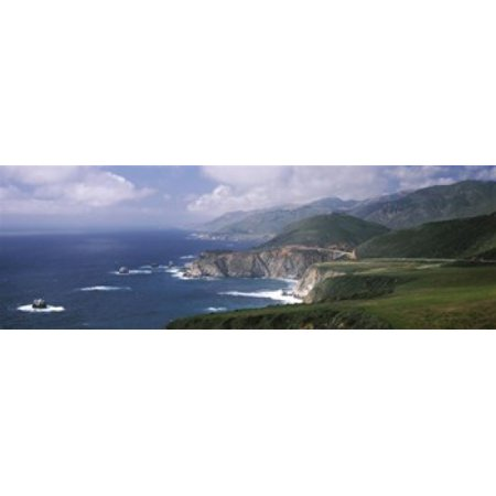 Rock formations on the beach Bixby Bridge Pacific Coast Highway Big Sur California USA Poster Print by Panoramic Images (60 x 20) Big Sur Coast Highway