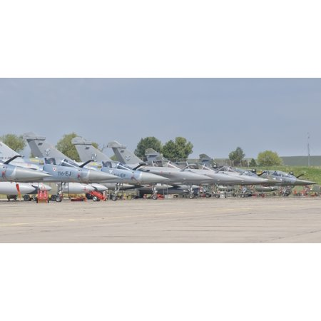 French Air Force Mirage 2000 aircraft and Royal Saudi Air Force planes on the flight line during Exercise Green Shield 2014 at Nancy Air Base France Poster - Nancy Air