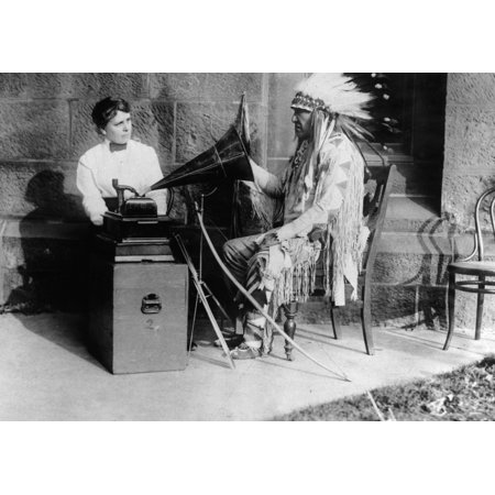 Blackfoot And Phonograph Nmountain Chief  Ninastoko  Chief Of The Blackfoot Native Americans Of Montana Listening To A Song On A Phonograph And Interpreting It In Sign Language To The Ethnologist Fran