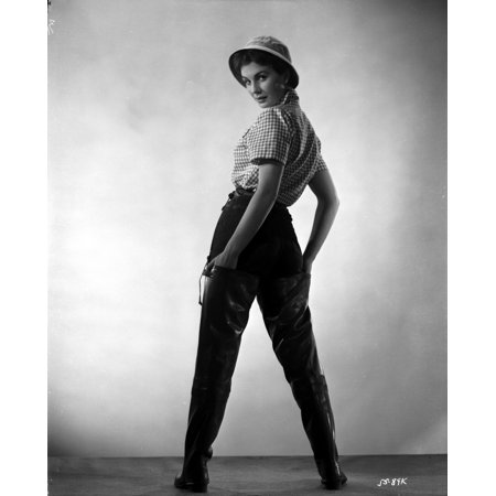 Jean Simmons Posed Facing Back in White Gingham Short Sleeve Shirt and Black Straight Cut Pants with White Round Hat in White Background Photo Print