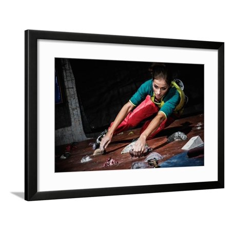 Young Woman Practicing Rock-Climbing on a Rock Wall Indoors Framed Print Wall Art By NejroN Photo