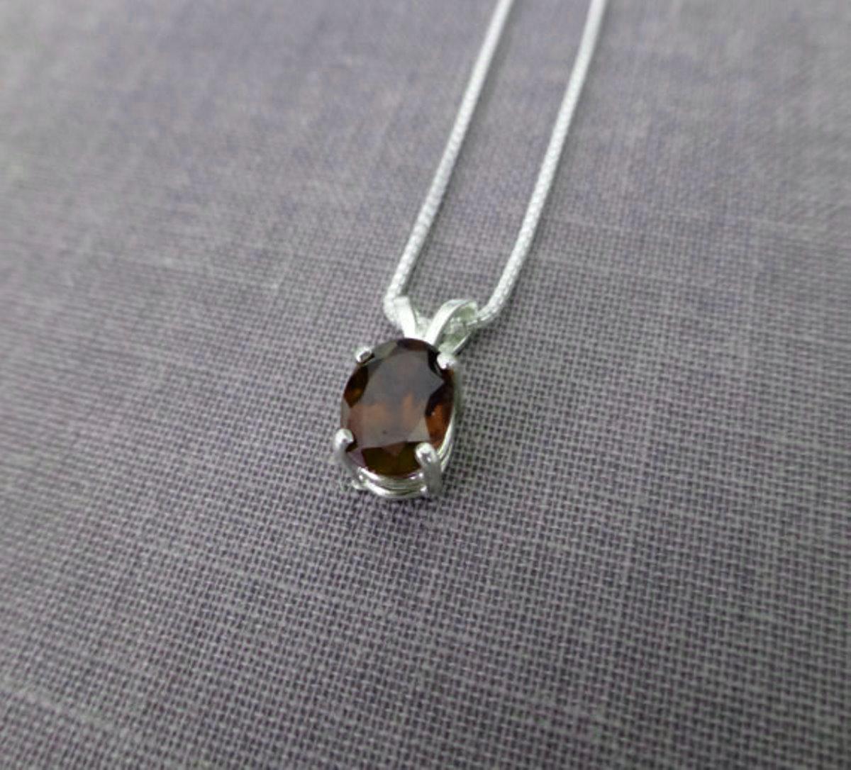Oval Shaped 1.55 Carat Natural Rhodolite  Garnet Set In 925 Sterling Silver Sun Garnet