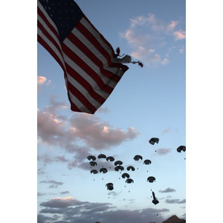 Fall Afghan (LAMINATED POSTER A cargo airdrop falls over Forward Operating Base Baylough, Afghanistan, during a delivery by a U.S. Poster Print 24 x 36 )