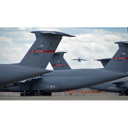 Canvas Print C-5 Galaxy tails on the flightline frame a C-5 on final approach May 19, 2014, to Westover Air Reser Stretched Canvas 10 x (Westover Wv)