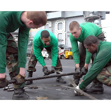 - LAMINATED POSTER Arresting Gear crew changes a leaf spring under a cross deck pendant aboard aircraft carrier USS Nim Poster Print 24 x 36
