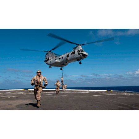 Marines fast rope on to the flight deck of USS New Orleans Poster Print by Stocktrek Images