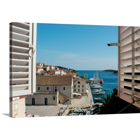 Great BIG Canvas Alison Jones Premium Thick-Wrap Canvas entitled Croatia, Dalmatian Coast, Hvar, Boats And Riva Seen Thru Shuttered