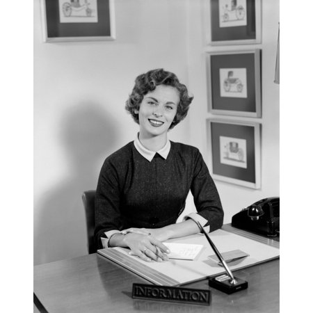 1950s Paper (1950s Woman Sitting At Information Desk In Office Holding Pencil And Paper Poster Print By Vintage)
