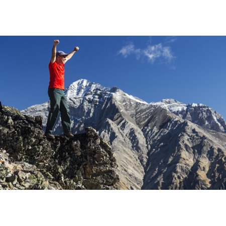Male Hiker Standing With Arms Raised In The Air On Top Of Mountain Ridge Overlooking Snow Peaked Mountains With Blue Sky And Clouds Kananaskis Provincial Park Alberta Canada Posterprint