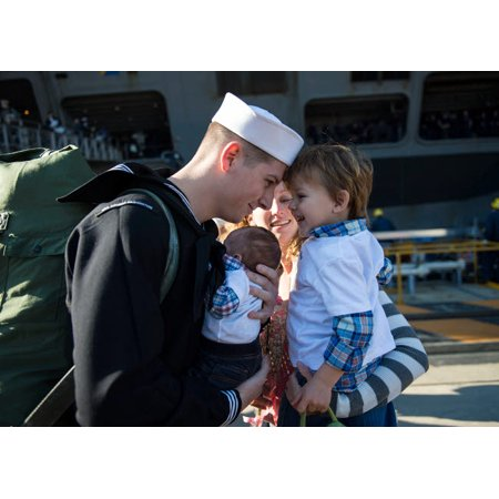 US Navy sailor greets his family on the pier at homecoming Poster Print by Stocktrek Images - Halloween At Navy Pier