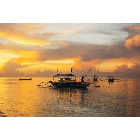 Beautiful sunrise in Alona Beach a man moving his boat to reach the shore with a long stick Panglao Island Bohol Philippines Canvas Art - Luis Martinez  Design Pics (19 x 12) ()