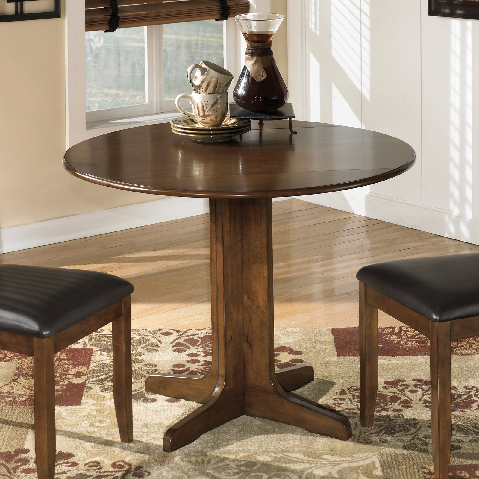 Signature Design by Ashley Stuman Round Dining Table