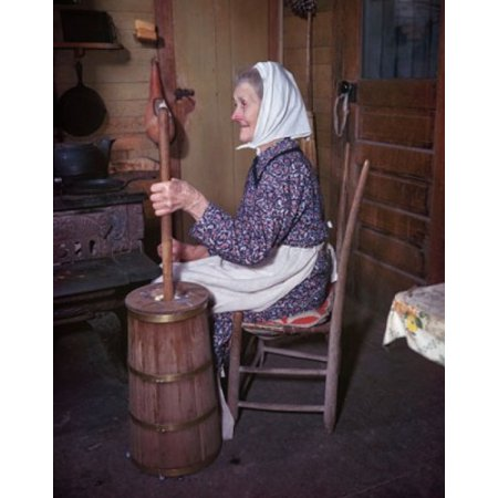 Side profile of a senior woman sitting and churning butter Canvas Art - (18 x 24)