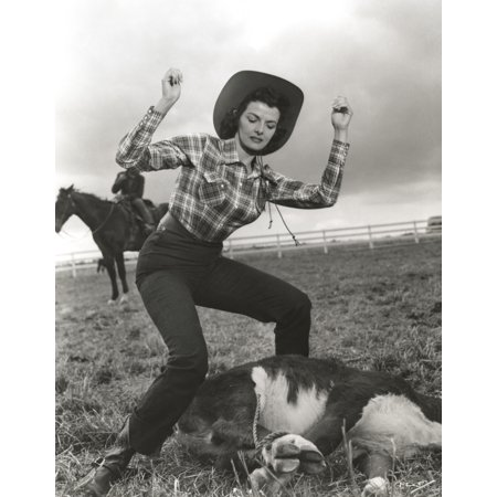 Jane Russell Posed in Checkered Tight Long Sleeve Collar Shirt and High Waist Linen Pants with Cowboy Hat while Hands Raised Up and Feet Apart Photo - Rydell High