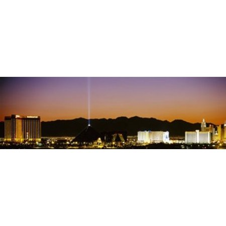Buildings in a city lit up at night Las Vegas Nevada USA Canvas Art - Panoramic Images (18 x 6)