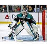 John Gibson Anaheim Ducks Unsigned Mighty Ducks Alternate Jersey in Net Photograph