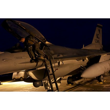 - LAMINATED POSTER A U.S. Air Force F-16 Fighting Falcon pilot readies his jet for a training mission early in the morn Poster Print 24 x 36