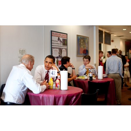 President Obama And Vp Joe Biden Wait For Their Lunch During A Visit To RayS Hell Burger In Arlington Virginia May 5 2009