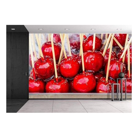 wall26 - Sweet Glazed Red Toffee Candy Apples on Sticks for Sale on Farmer Market or Country Fair. - Removable Wall Mural | Self-adhesive Large Wallpaper - 100x144