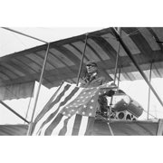 Buy Enlarge 0-587-46052-LP12x18 Aviator C. B.  Harmon Unfurls Stars and Stripes from his pilot seat on his Biplane. - Paper