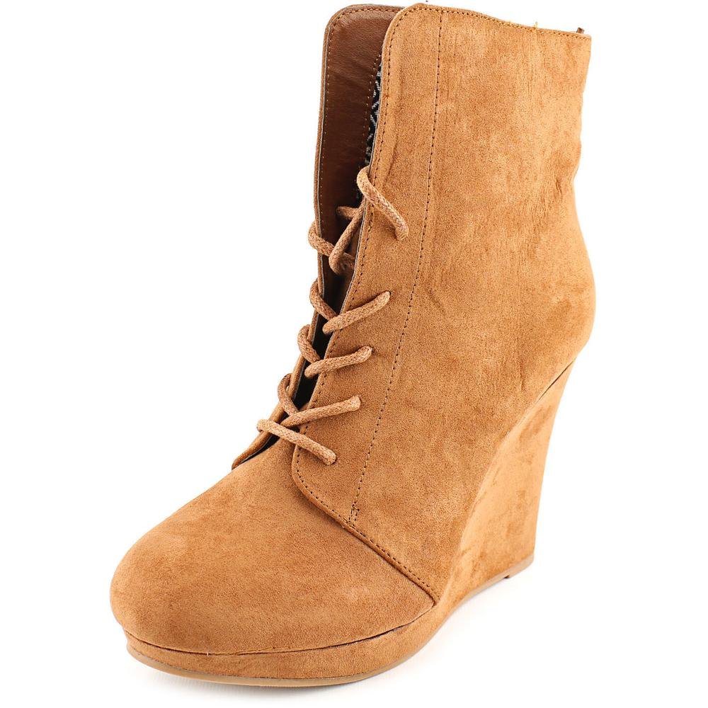 Famous Name Brand Nomad Round Toe Synthetic Bootie by Famous Name Brand