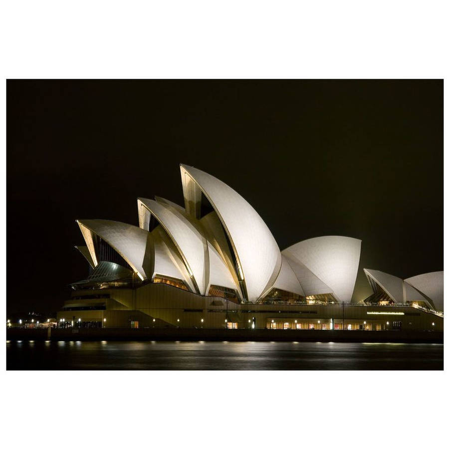 Australia, Sydney, A Night Scene Looking Across Sydney Harbor To The Iconic Opera House by Eazl Cling