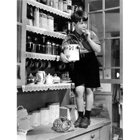 Bench Cookie (Film Still of Bob Watson standing on kitchen bench with a cookie jar Photo Print)
