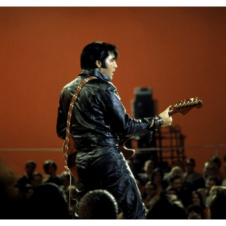 Elvis Presley performing in a leather jacket and pants Photo Print