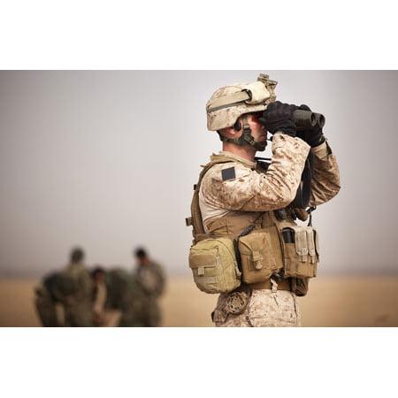 US Marine determines target placement at a target range in Afghanistan Poster Print by Stocktrek -