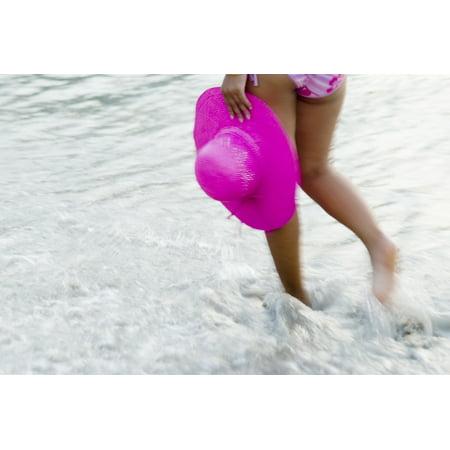Thailand Phuket Kata Noi Blurred Action Shot Of Womans Legs Walking Through Water Holding Hat Posterprint