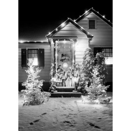 christmas decorations outside house at night poster print