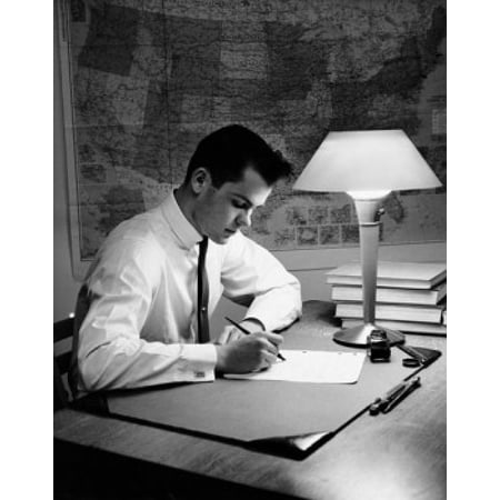 Young man writing on a sheet of paper Canvas Art - (24 x 36)