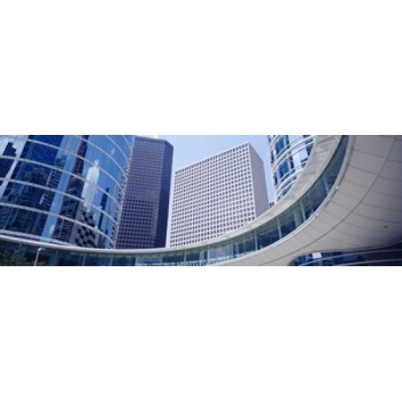 Low angle view of buildings in a city Enron Center Houston Texas USA Poster