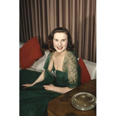 Deanna Durbin forest green gown laced shoulders on couch smiling 24x36 (Deanna Durbin Beneath The Lights Of Home)