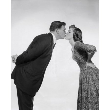Side profile of a young couple kissing Poster Print