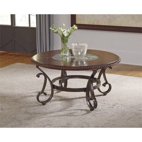 Ashley gambrey round coffee table in reddish brown for Meuble ashley circulaire