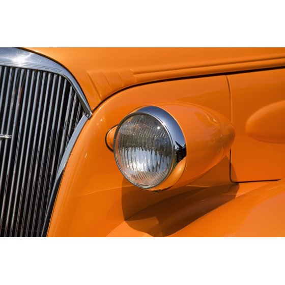 Vintage Automobile Front Center With One Headlight : Orange painted vintage cars headlight and front grill port