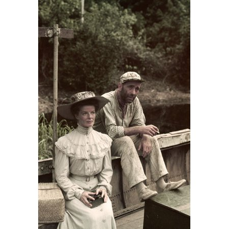 Humphrey Bogart and Katharine Hepburn in The African Queen dry clothing on edge of boat 24x36 (African Queen Boat)