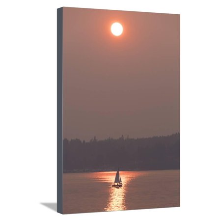 USA, Washington State. Two people in sailboat. Smoky skies from wildfires create eerie sunset Stretched Canvas Print Wall Art By Trish