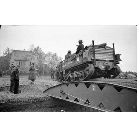 LAMINATED POSTER The British Army in North-west Europe 1944-45 A universal carrier crossing a temporary bridge in Moe Poster Print 24 x 36
