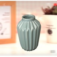 Creative Motion Ceramic Flower Vase in Blue Product Size: 4x4x6