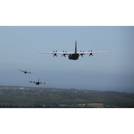 LAMINATED POSTER Three U.S. Air Force C-130Js, assigned to the 37th Airlift Squadron, flies in formation over the ter Poster Print 24 x