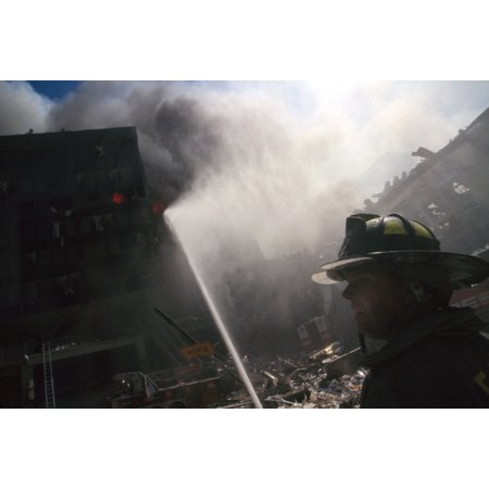 Fire Fighter At World Trade Center Site Following September 11Th Terrorist Attack In The Center Background Is The Burning Pile Of The Collapsed Wtc 1 New York City