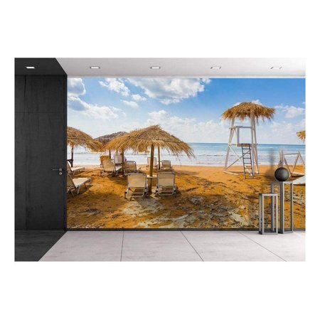 Mediterranean Mural (wall26 - Sun Umbrellas Made of Dry Vegetation, Sun Beds and a Lifeguards 'S Tower at The Mediterranean Sea - Removable Wall Mural | Self-Adhesive Large Wallpaper - 100x144 inches)
