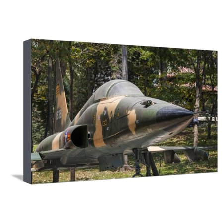 Vietnam, Ho Chi Minh City. Reunification Palace, Former South Vietnamese F-5E Fighter Plane Stretched Canvas Print Wall Art By Walter