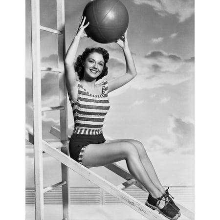 Photo Holding Ball - Virginia Gibson holding a ball Photo Print