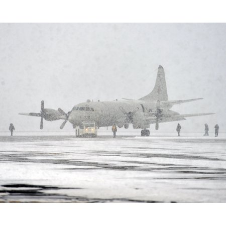 LAMINATED POSTER Sailors assigned to the Grey Knights of Patrol Squadron (VP) 46 move a P-3C Orion aircraft at Naval Poster Print 24 x 36