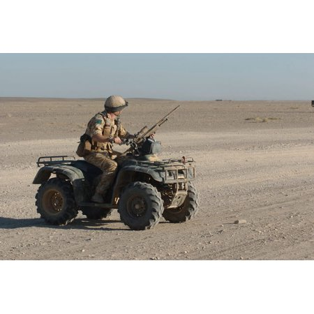 Armor Atv (A British Army soldier provides security on a ATV Poster Print by Andrew ChittockStocktrek Images)