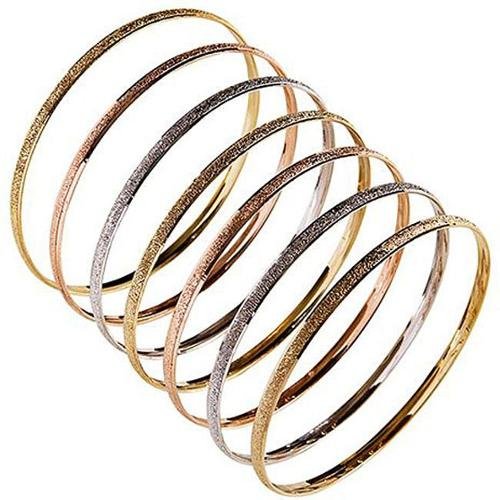 NEXTE Jewelry Nexte 14k Tri-color Gold Stackable Textured 'Semanario' Bangle (Set of 7)